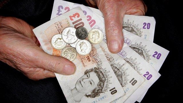 Elderly person holding money