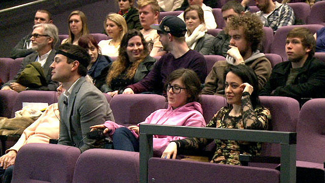 A cinema audience wearing equipment to monitor mood changes