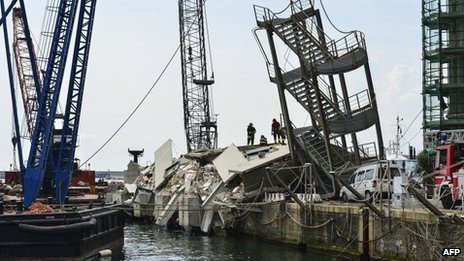 Aftermath of an accident involving the Jolly Nero container ship in the port of Genoa, 8 May 2013