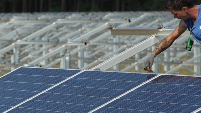 Man measuring solar panels