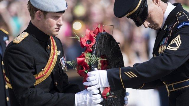 Prince Harry laying wreath