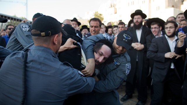 """Israeli police officers arrest an ultra-Orthodox protestor objecting to the religious group """"Women Of The Wall"""""""