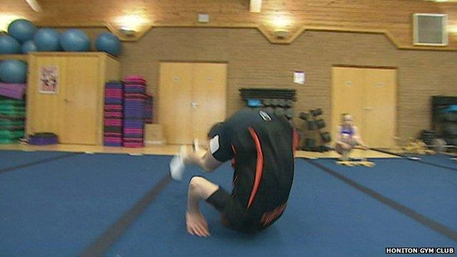 Ashley Wallis doing a forward roll
