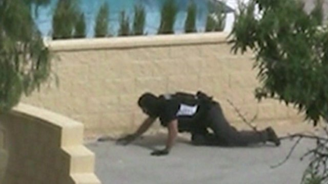Policeman creeping up on Moran