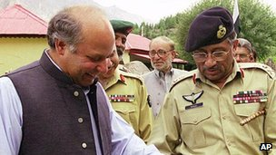 Prime Minister Nawaz Sharif, left, and Gen Pervez Musharraf look at a light machine gun captured from Indian soldiers during the Kargil crisis in Kashmir in this undated file photo.