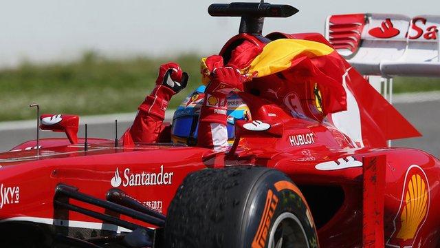 Fernando Alonso celebrates winning his home Grand Prix