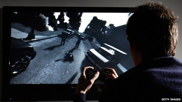 Man playing Grand Theft Auto IV