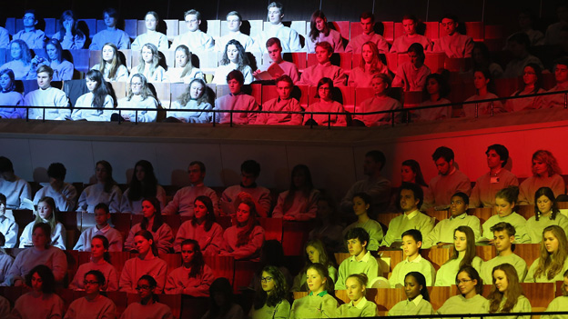 Children bathed in lights of French and German flags