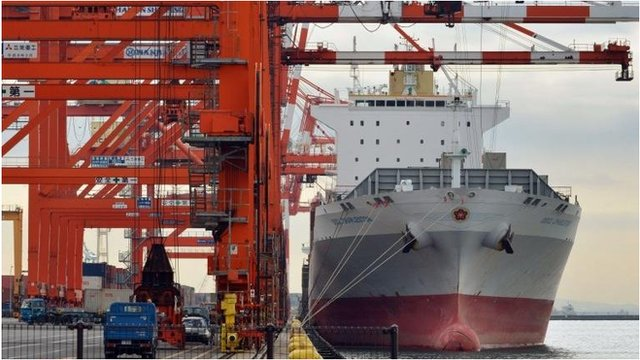 Ship being unloaded in Tokyo port