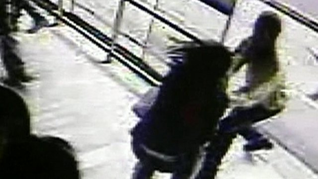 CCTV of man grabbing a woman's phone