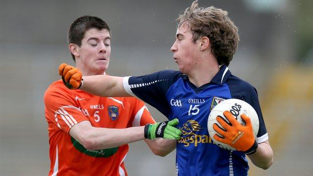 Jamie Cosgrove of Armagh tries to win the ball off Cavan's David Brady
