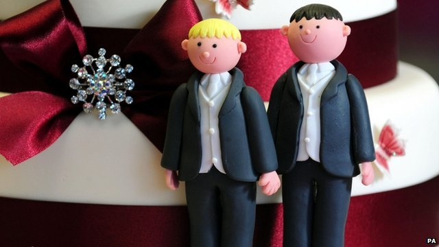 Two grooms on a wedding cake