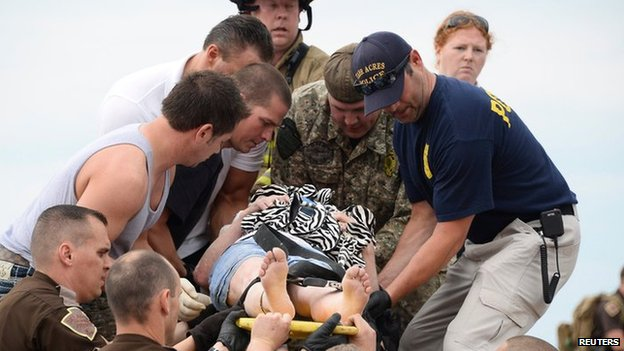 Rescue workers carry a woman to safety from the Moore Medical Center