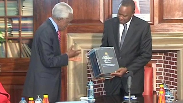 Uhuru Kenyatta receiving the report