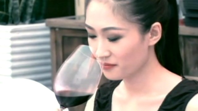 Chinese woman with red wine
