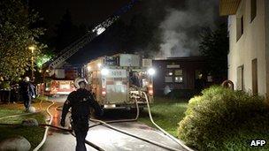 Firemen extinguish blaze at nursery school in Stockholm suburb of Kista. 24 May 2013