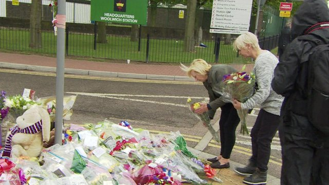 Locals lay flowers at the scene of the attack