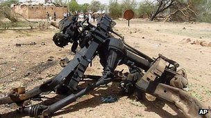 Twisted debris outside the military camp in Agadez. 23 May 2013