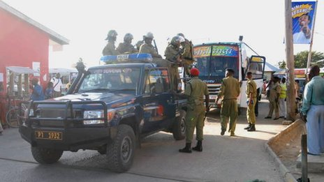 Police escort busses headed to Mtwara from a nearby town of Lindi