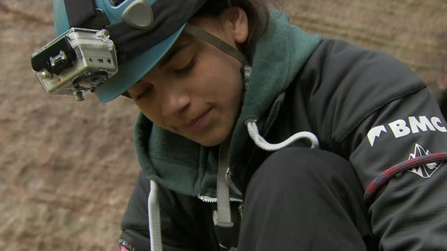 Molly Thompson-Smith preparing to climb