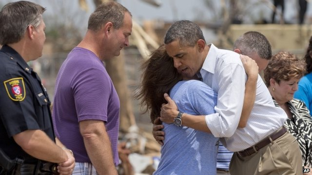President Barack Obama embraces an official from the devastated Plaza Towers Elementary School