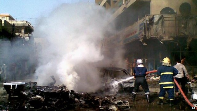 Firefighters extinguish car bomb blaze, Baghdad (27 May)