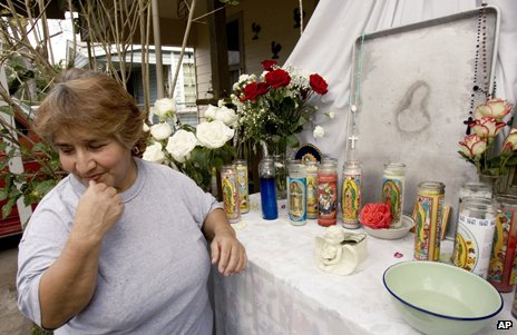 Makeshift shrine to a likeness of Virgin Mary on a baking tray in Houston, Texas, 2007