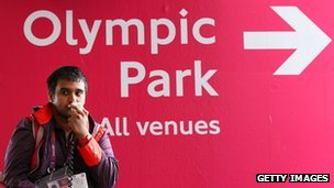 A steward directs spectators during the London 2012 Games
