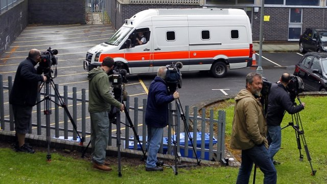 Cameramen record Mark Bridger's arrival as Mold Crown Court