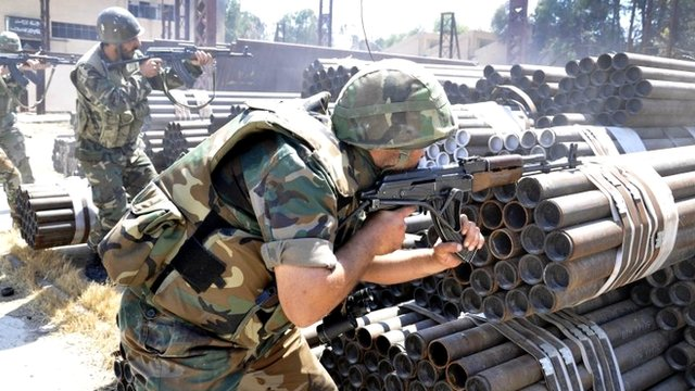 Syrian forces take their position against rebels in Aleppo