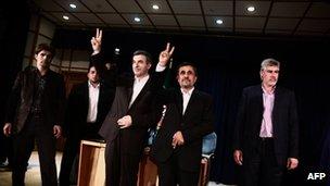 Iranian President Mahmoud Ahmadinejad and Esfandyar Rahim Mashaie make the victory sign during a press conference