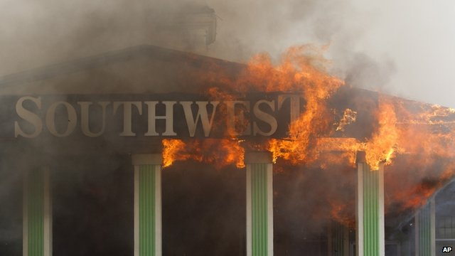 Southwest Inn sign engulfed in flames