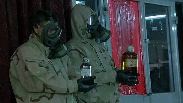 Two Iraqi soldiers hold what is claimed to be chemical weapons