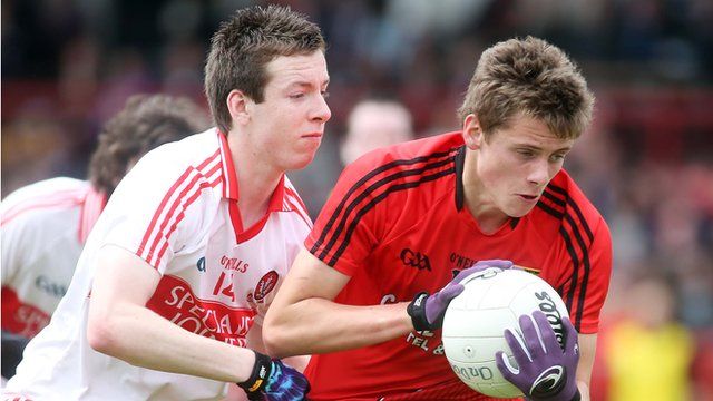 Niall Loughlin of Derry competes for the ball with Down's Pat Havern in the Ulster Minor Football Championship match