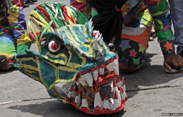 A dancer holds a mask in Naiguata on 30 May 2013