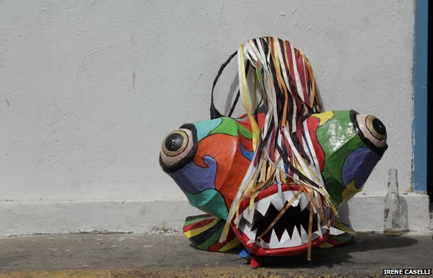 A masks rests against a wall in Naiguata on 30 May 2013