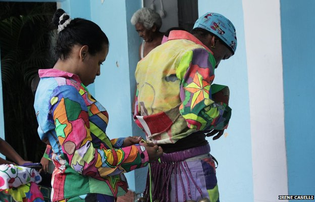Participants prepare their outfits before the festivities begin in Naiguata on 30 May 2013