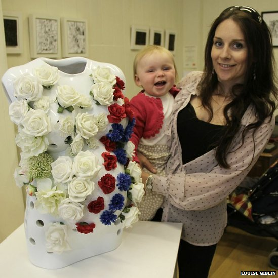 Blooming body cast model artist Rachel Lamb and baby Ava