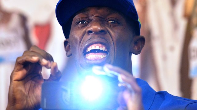Usain Bolt joking with the press