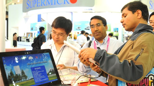 Foreign visitors inspect Chinese products on display at Computex in Taipei