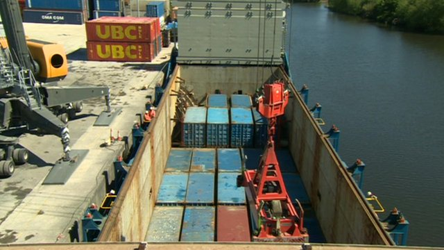A boat with freight containers