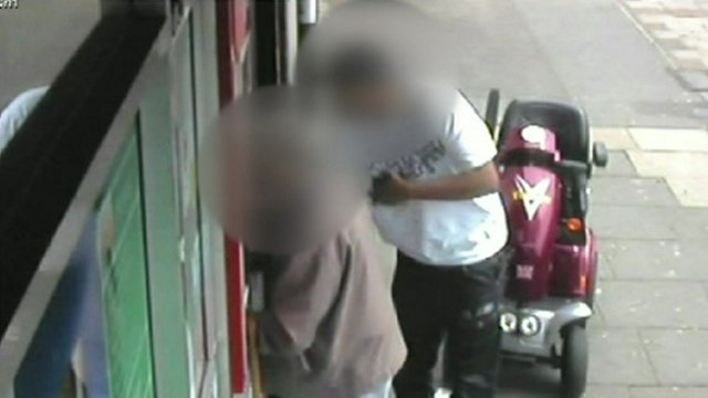 Still from CCTV footage shows a distraction robbery