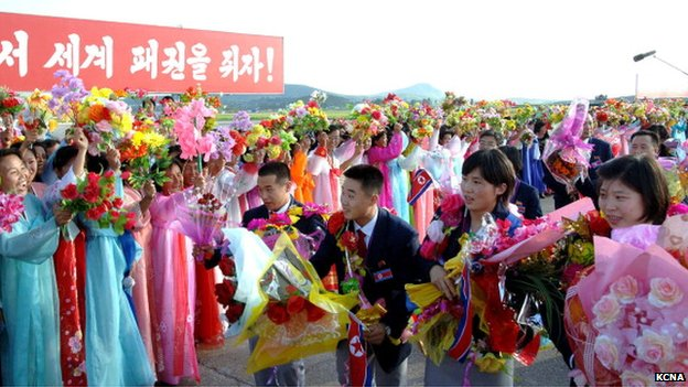 North Korean athletes returning from the Olympics in London last year