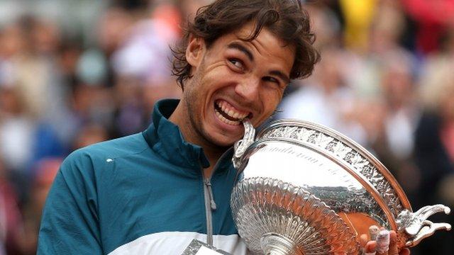 Rafa Nadal celebrates a record eighth French Open win