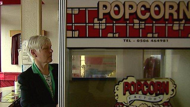 Woman at popcorn stall