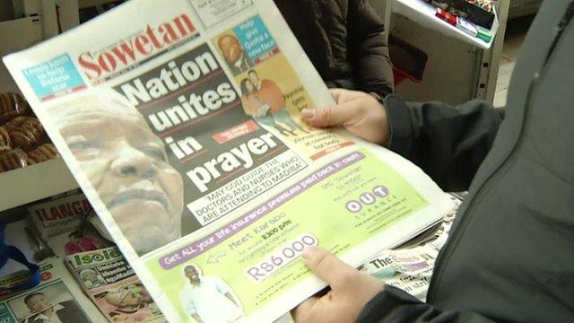 Gabriel Gatehouse holds a copy of the Sowetan newspaper