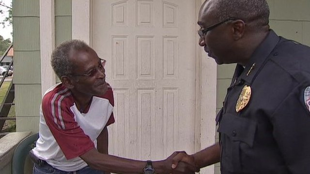 Sanford police chief shakes hand with resident
