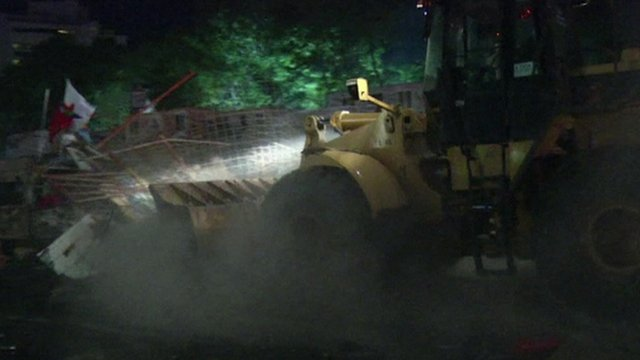 Bulldozer clears barricades in Taksim Square, Turkey