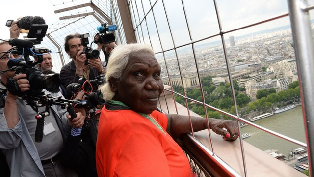 Artist Lena Nyadbi visits the Eiffel Tower during the inauguration of her giant art work