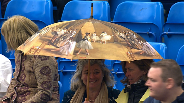 Lady holding umbrella